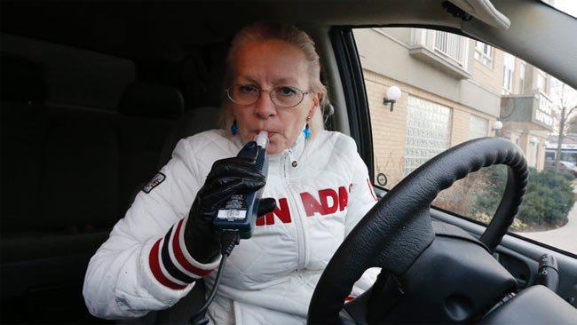 Anne Leonard, executive director Arrive Alive demonstrates an ignition interlock system -- many convicted impaired drivers are required to install such devices into their cars on December 4, 2014. (Michael Peake/QMI Agency)