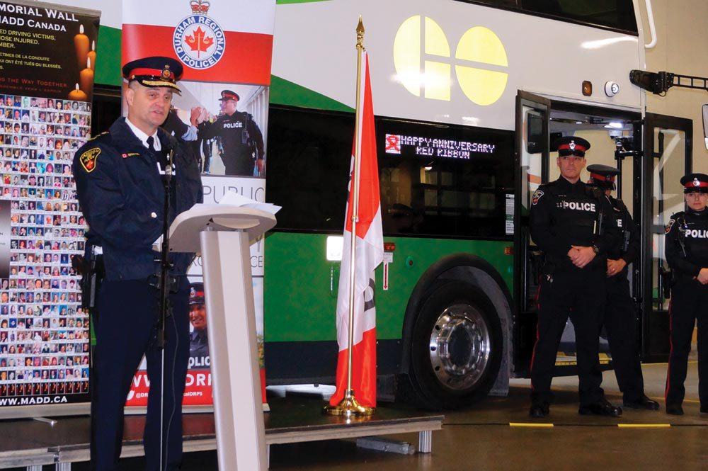 Durham Regional Police Chief Paul Martin speaks at the launch of the service's 2017 Festive RIDE program. Martin is flanked by members of the RIDE enforcement team. (Photo by Dave Flaherty)